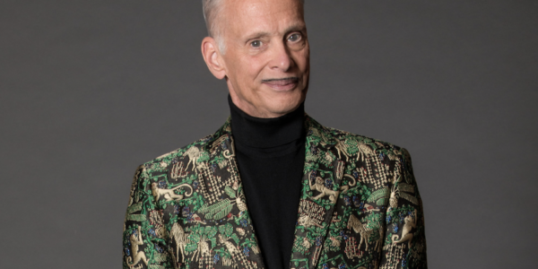 A man in a green suit